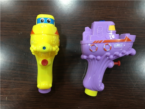 Two water gun candy toys and gifts small toys